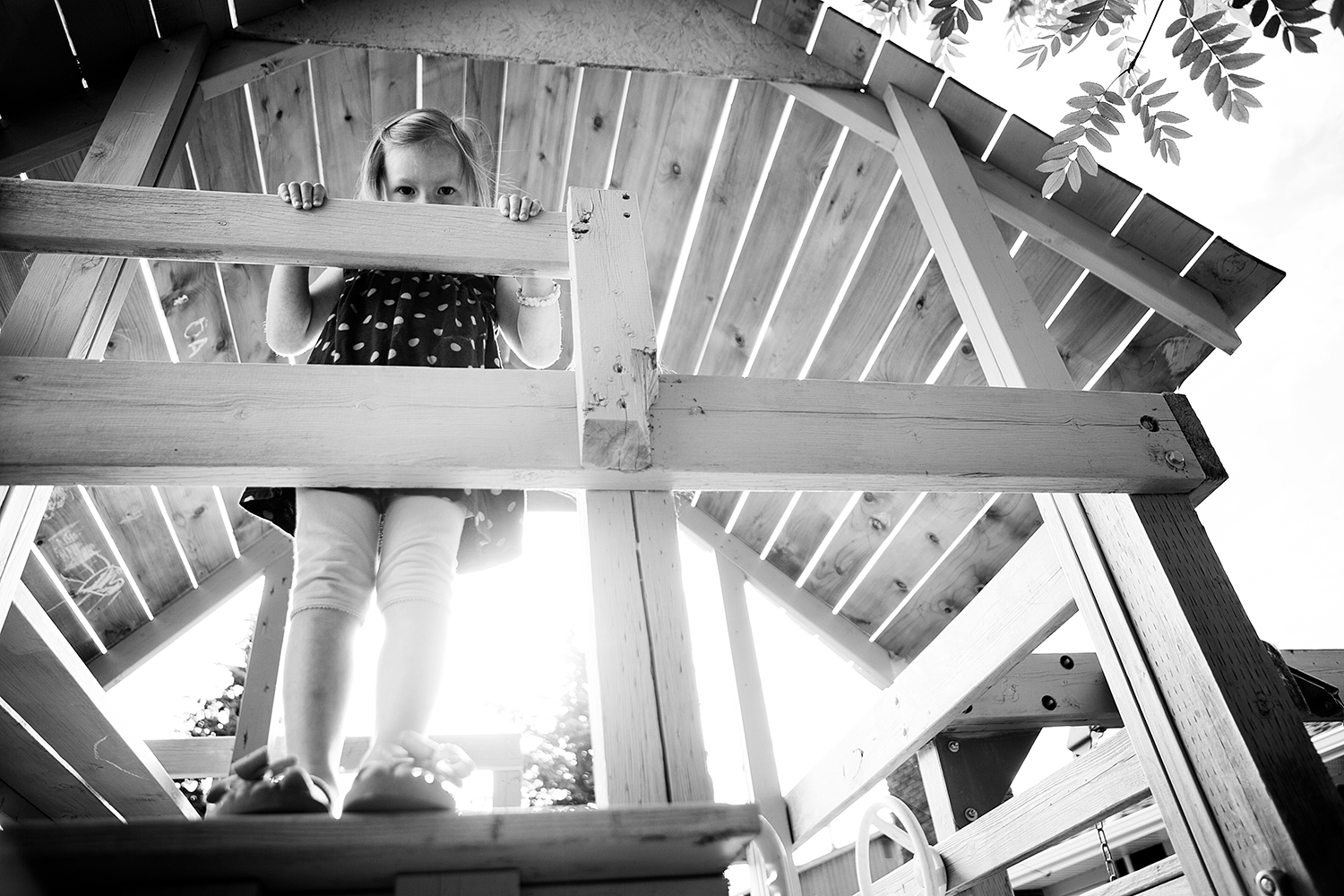 Editorial photograph of a child in a playhouse