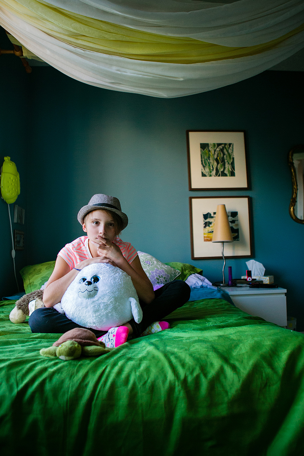 Editorial portrait of a tween girl in her bedroom
