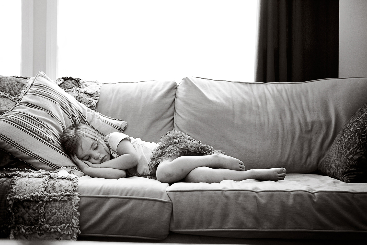 Toddler taking a nap in her living room by Dana Pugh