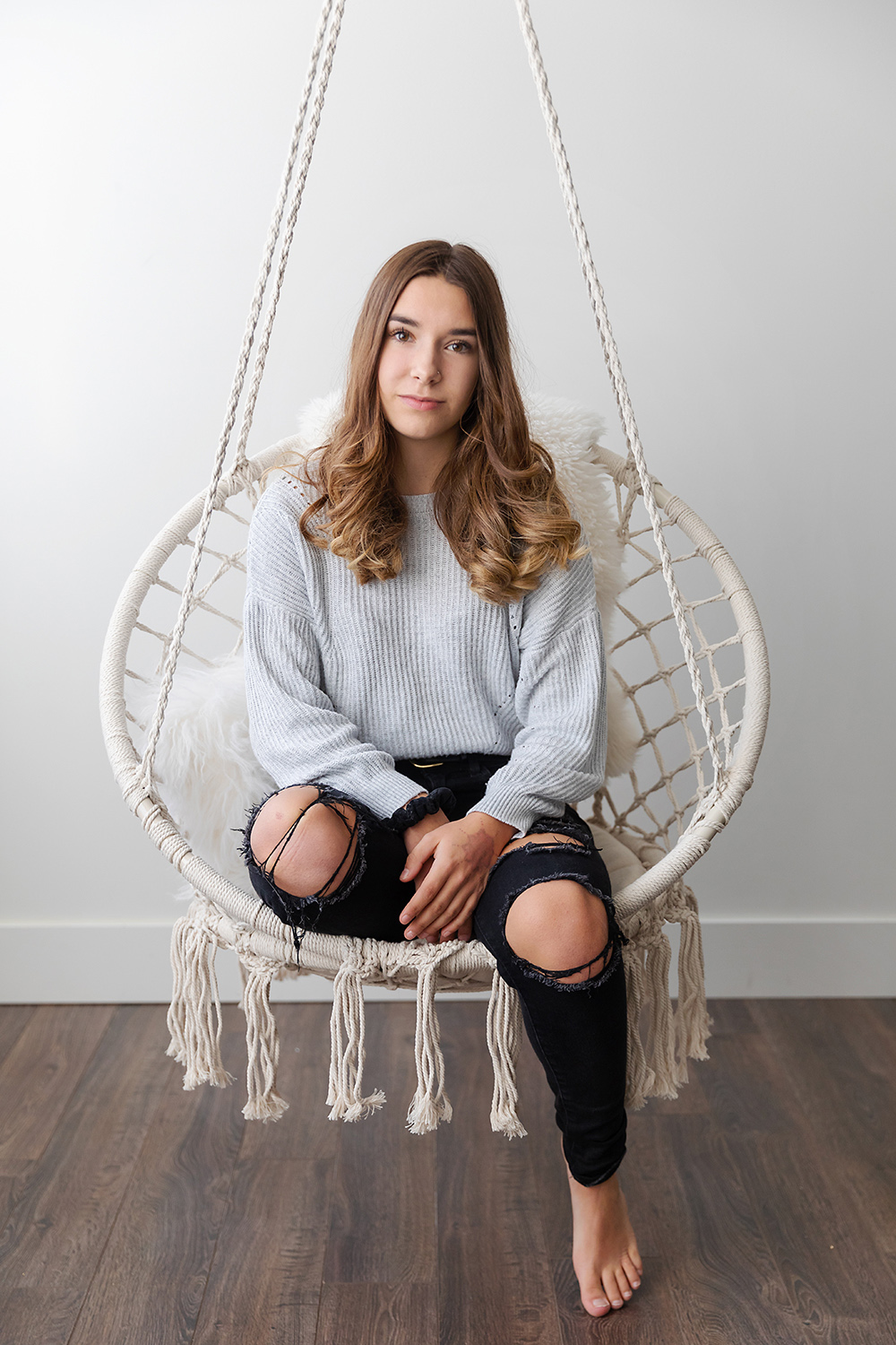 Teen girl on a crochet swing by photographer, Dana Pugh