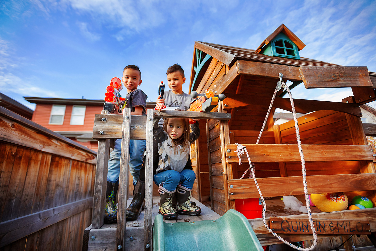 Editorial portrait of kids defending their playhouse