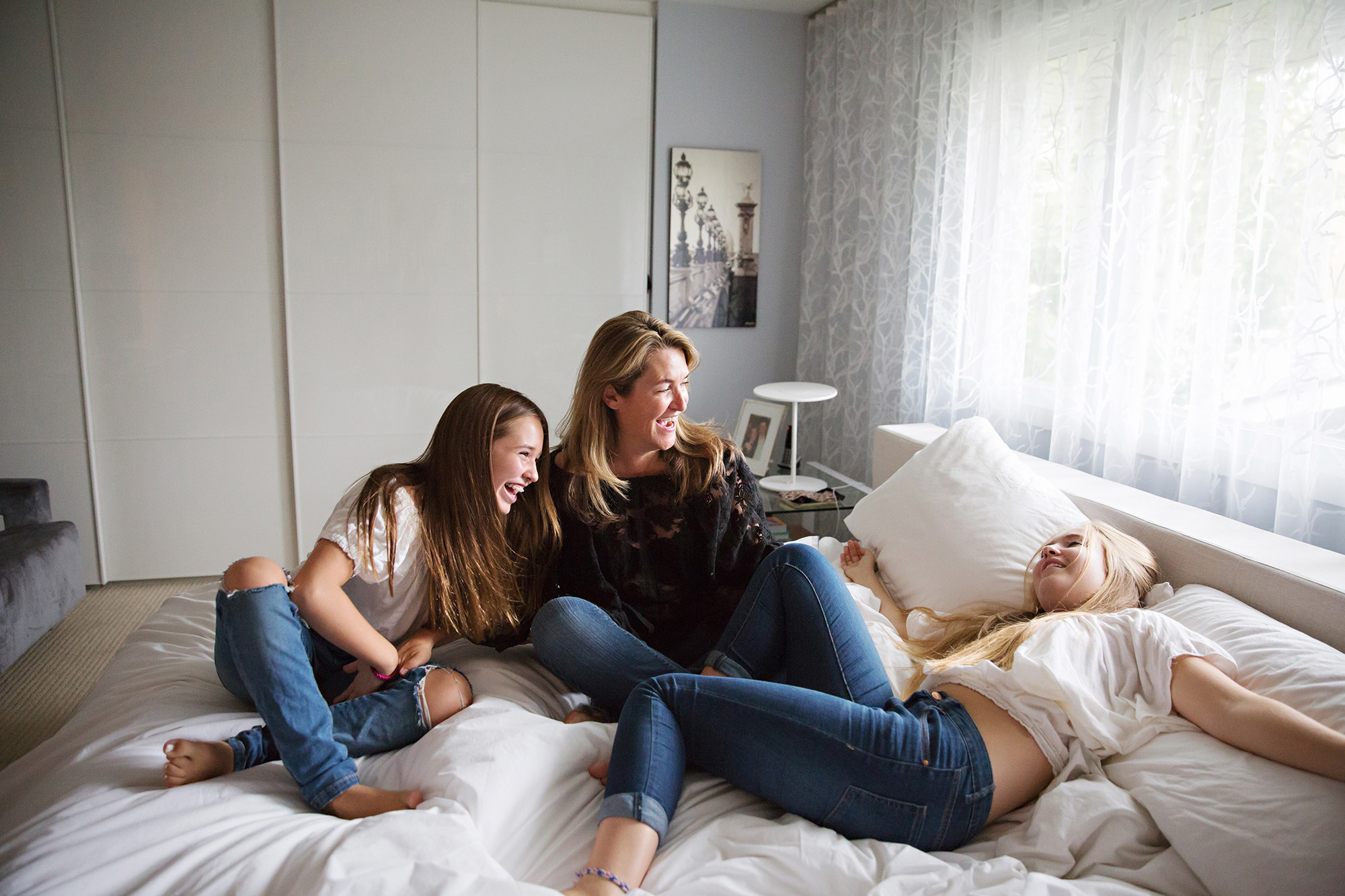 Mom and teenaged daughters goofing around