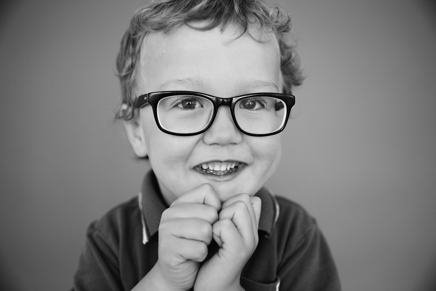 Cute portrait of a boy with glasses by Dana Pugh