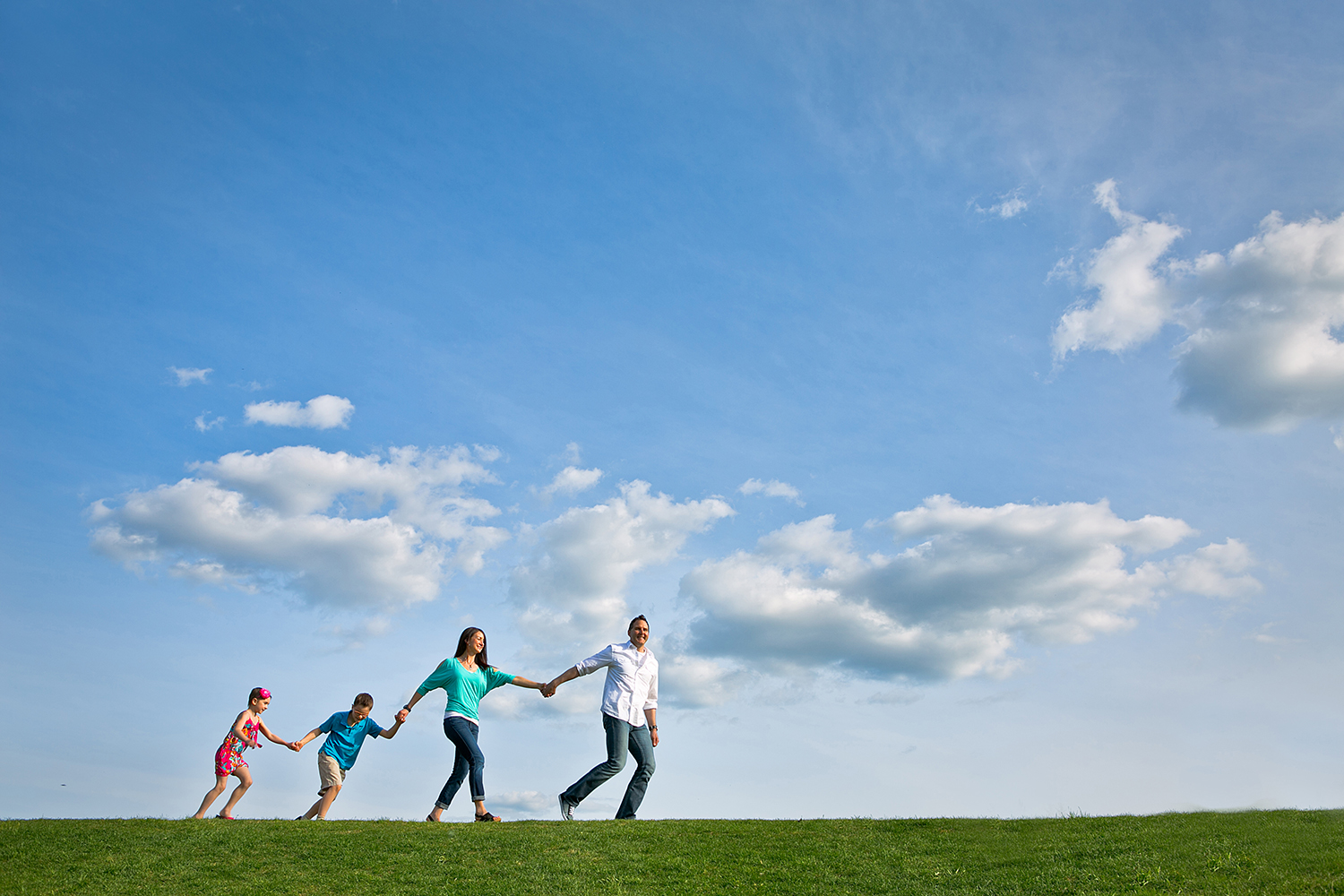 Family walking together under a beautiful blue sky