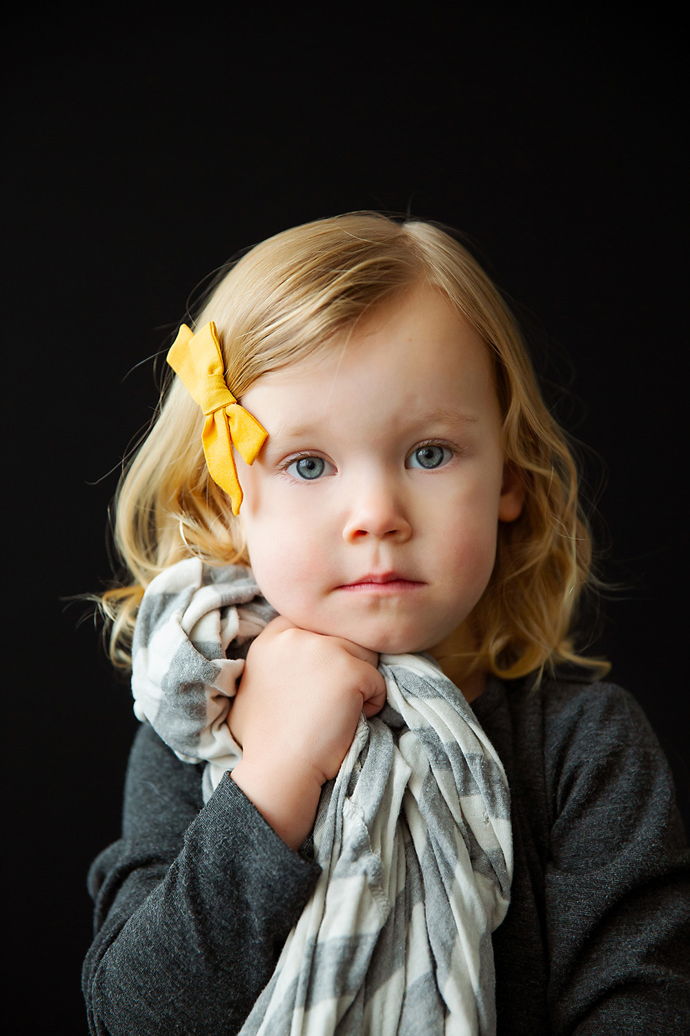 Studio portrait of a child with her blanket