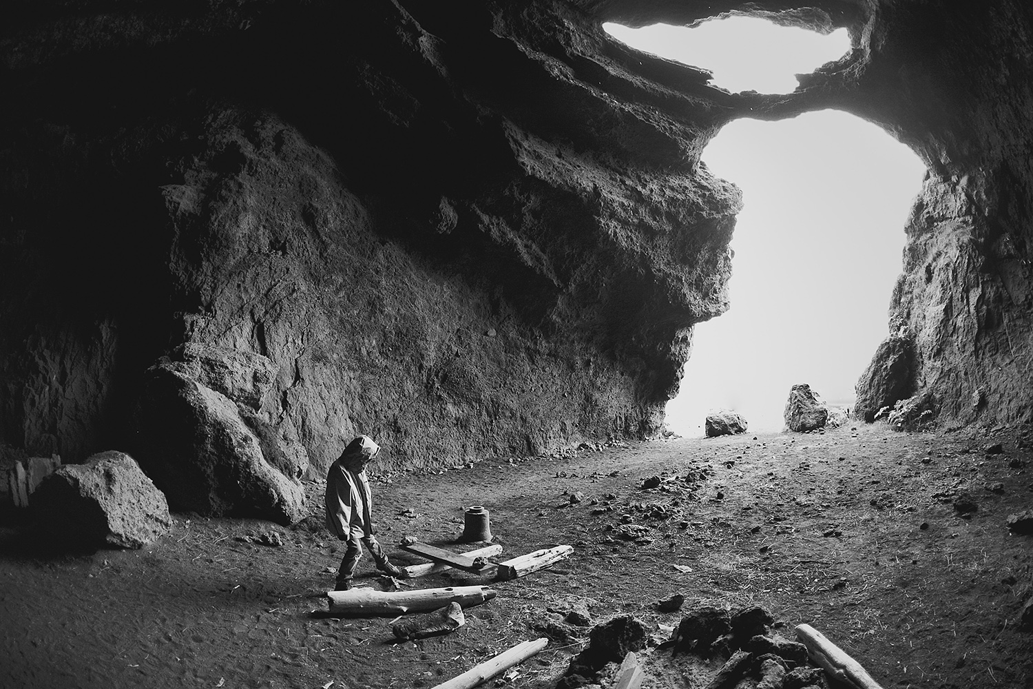 Boy playing in a cave in Iceland