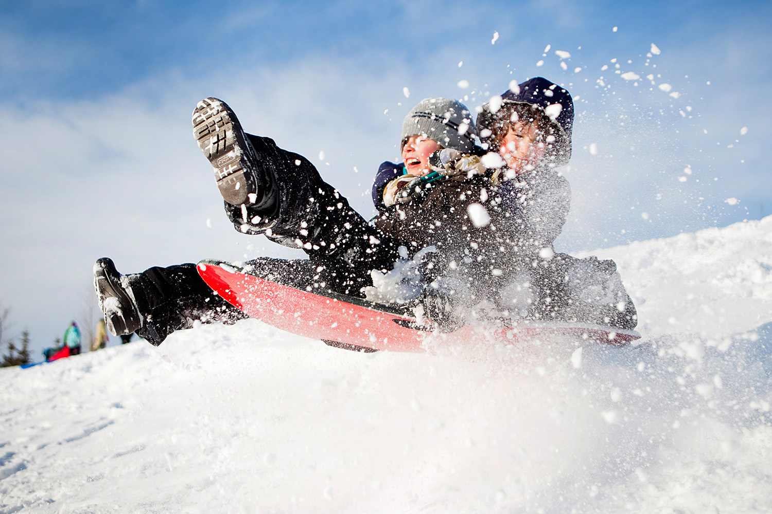Editorial image of two boys sledding