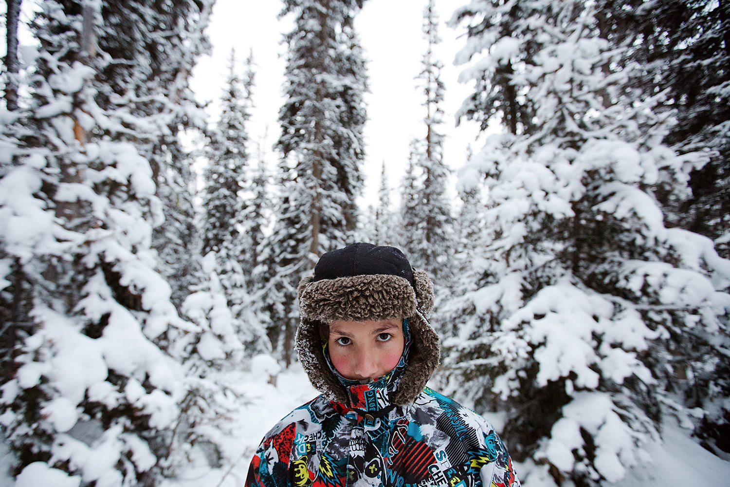 boy in the deep snow in Lake Louise