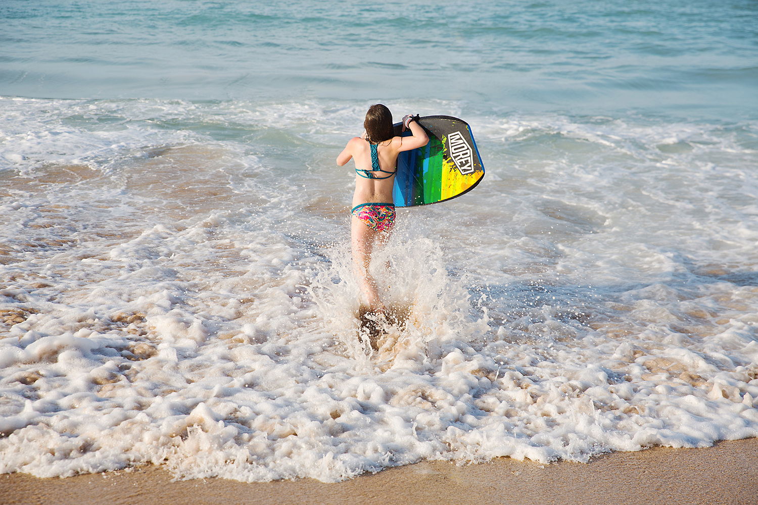 hitting the surf with a boogie board in Hawaii