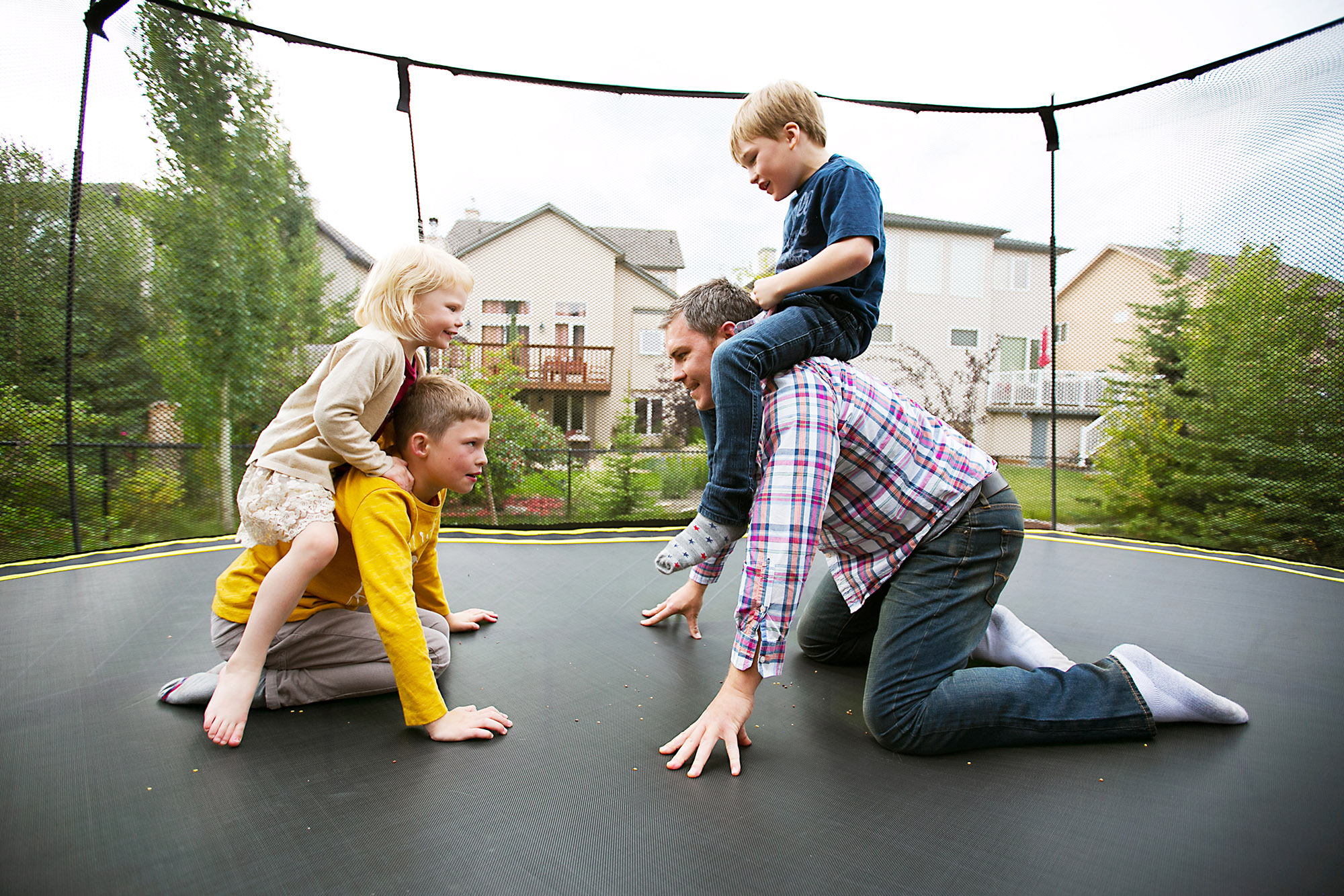 Family playing together on a trampoline