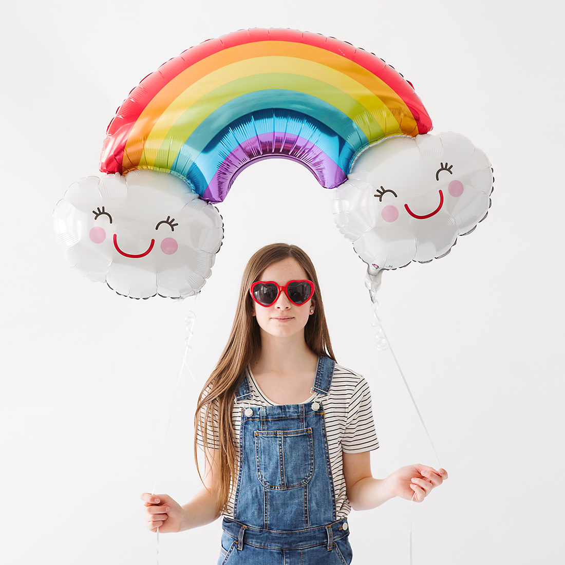 Teen girl with rainbow balloon