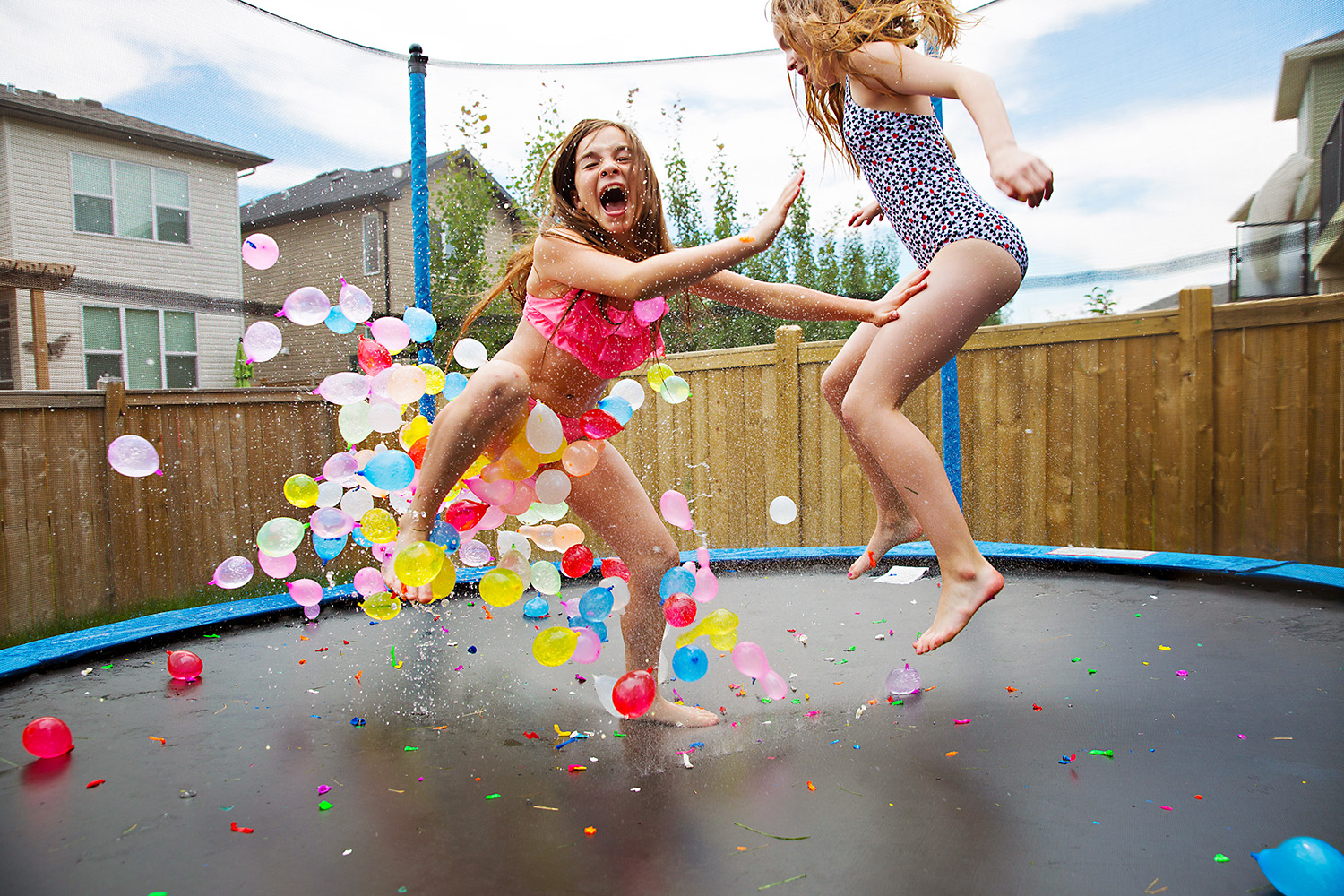 Jumping on the trampoline with water balloons and a sprinkler