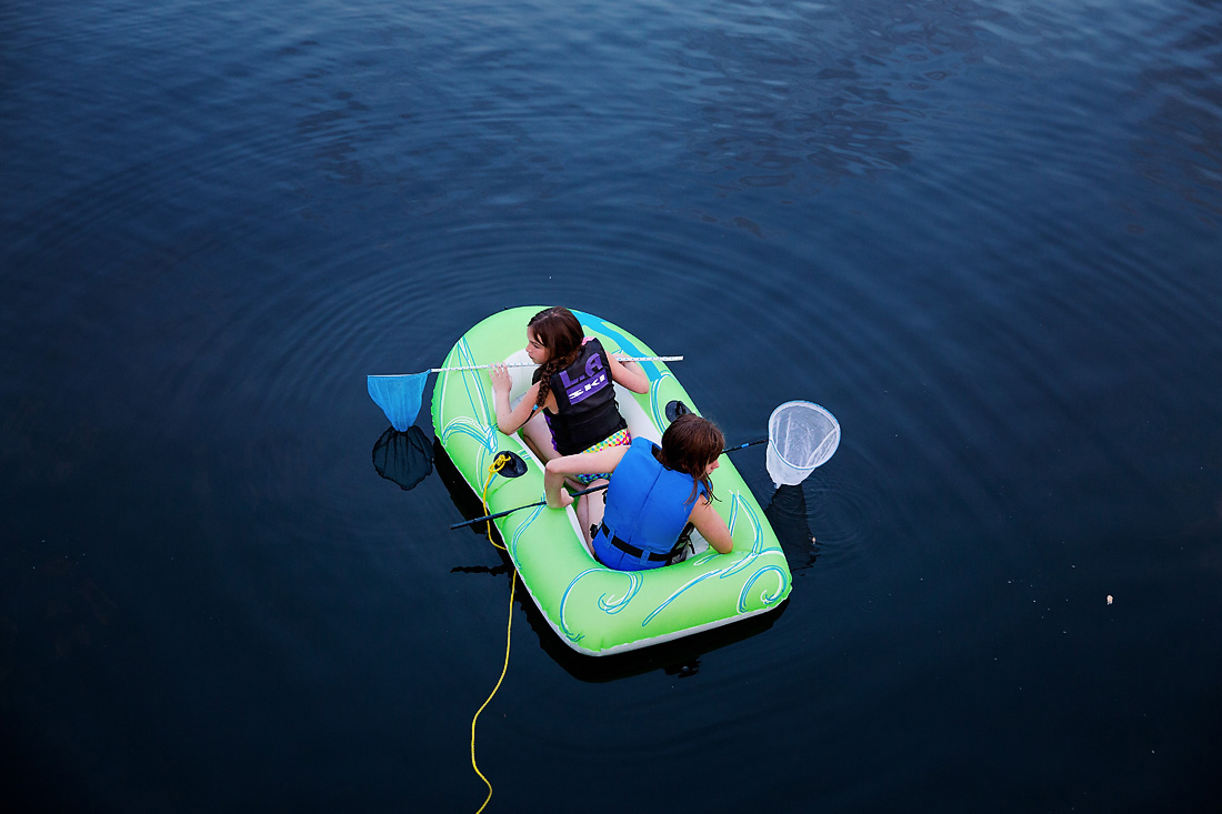 Sisters floating in a raft