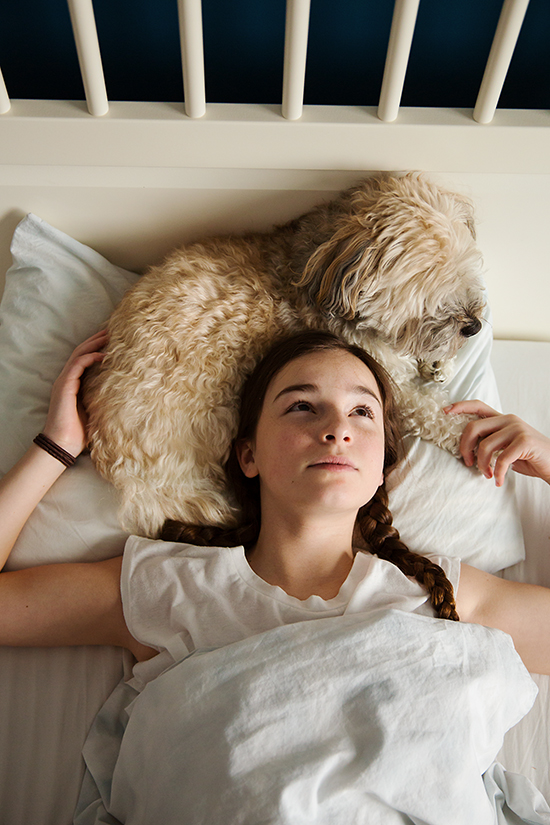 teen girl with her dog