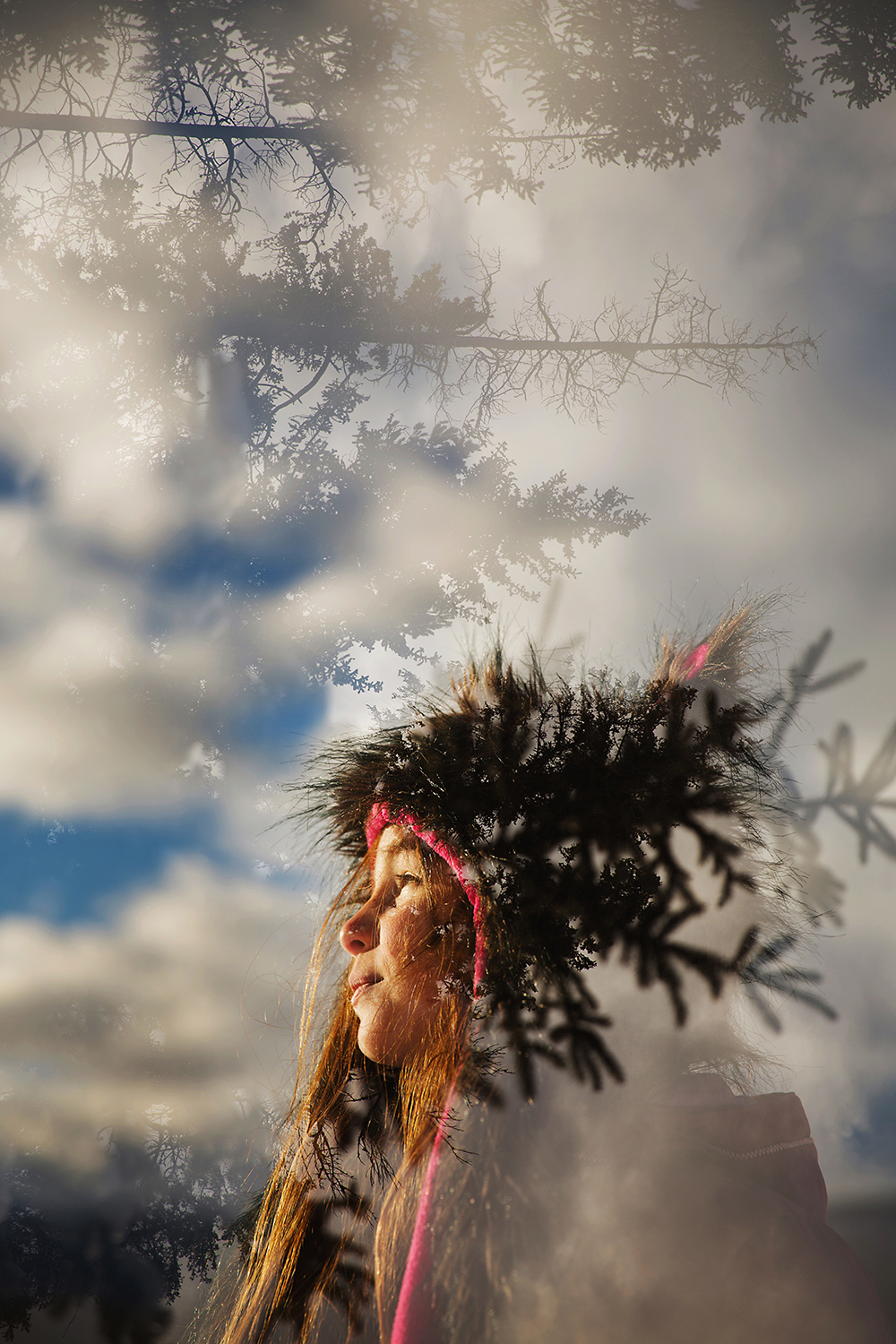 Double Exposure of a little girl and a winter skyline